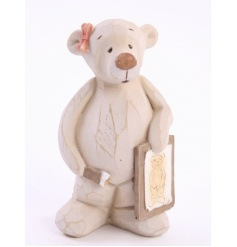 This creamy rough-cut resin bear from Heaven Sends