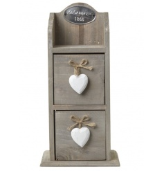 Wooden storage chest with two drawers and white heart decorations on the front