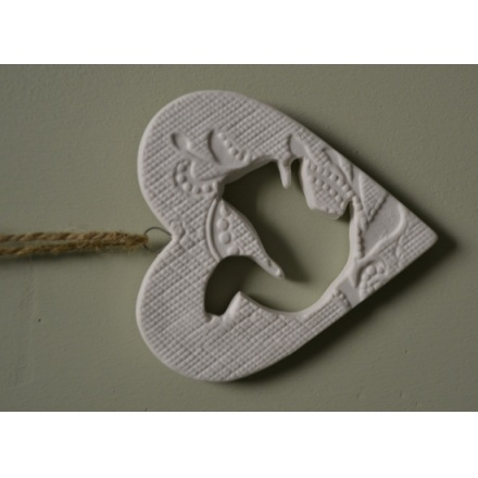 Ceramic deer and squirrel hanging heart decorations with patterned print and jute string to hang.