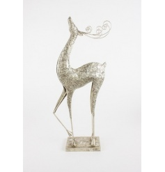 Glamorous large reindeer with a decorative silver finish and attractive antlers.