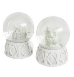 An assortment of 2 snow globes from heaven sends with winter scene inside