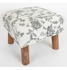 Cushioned stool with floral patterned material