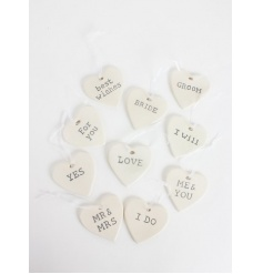 Perfect wedding favours or decorations, small hearts each with marriage phrases