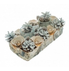 A natural bark tray with two glass t-light holders set within a wooden pinecone and floral display.