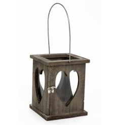 A chunky wooden grey washed lantern with glass hearts and a wire handle