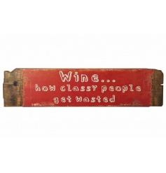 A rustic wooden plank sign reading 'wine...how classy people get wasted'.