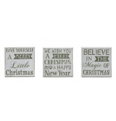A mix of three small square festive signs in white and silver glitter with popular slogans.