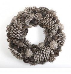 A stunning natural gold wreath made from pinecones.