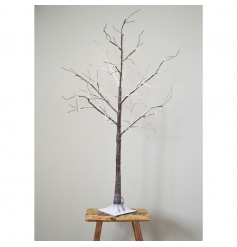 Decorative twig tree with a snowy finish and LED lights