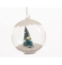 Hanging glass bauble with white winter scene inside and LED lights