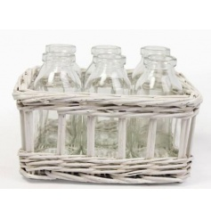 6 glass vases in a white willow container