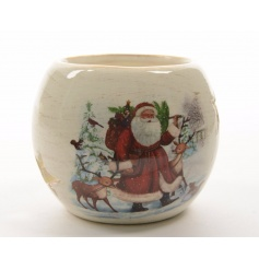 A traditional terracotta t-light holder with a vintage Santa design.