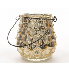A stylish antique champagne gold hurricane lantern with a pinecone design.