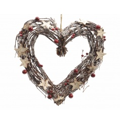 A rustic twig heart wreath with red berries, bark stars and a dusting of glitter.