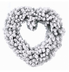 A pretty heart shaped wreath with a festive snowy finish