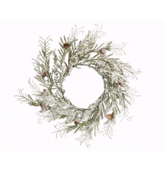 A rustic woodland style wreath with glitter snow and pinecones.