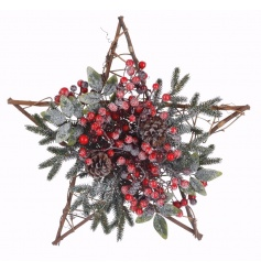 A willow hanging star decoration with frosted red berries and pinecones.