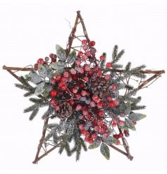 A beautiful willow star decorated wrapped with festive foliage, red berries and pinecones.