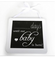 White wooden chalk board with 'Days until our baby' script