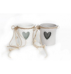 Chic candle holders in tonal colours with heart cutout