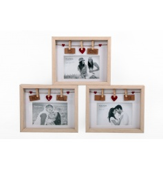 An assortment of 3 wooden picture frames with peg detail
