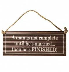 A rustic corrugated metal sign with a humorous married man quote