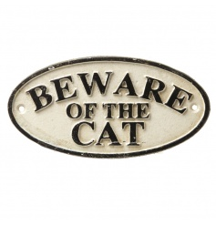 A cream and black beware of the cat sign for inside and outside of the home.