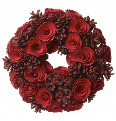 Traditional red pinecone wreath, essential item for a doorway or window display during the festive season