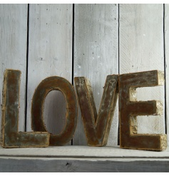 A large rustic LOVE sign with individual birch and iron letters.