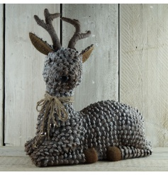 A stunning rustic pinecone reindeer decoration with bells. A chic display item to enjoy each year.