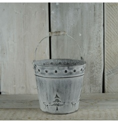 A festive whitewashed bucket with Christmas design