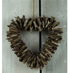 Decorative bark wreath in a heart shape with rustic finish