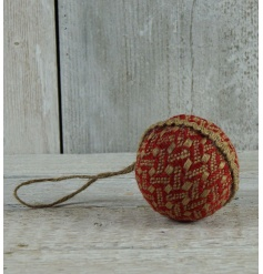 A charming red and cream woven natural bauble with an intricate pattern and jute hanger.