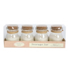A set of 4 glass storage jars with cork lid and scented candle inside
