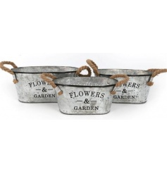 A rustic set of 3 metal planters with rope handles