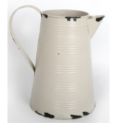 Metal jug in a rustic and antique design, perfect for flowers and kitchen use