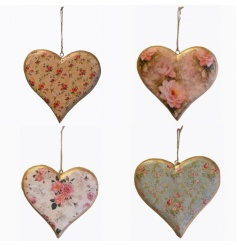 A decorative assortment of four hanging hearts with floral pattern