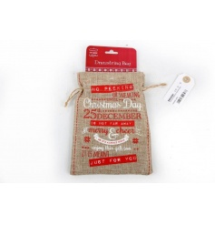 A rustic hessian bag with a drawstring and festive no peeking slogan.