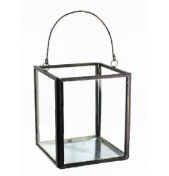 Decorative glass candle holder with metal frame and handle