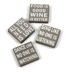 An assortment of 4 mini wooden magnet signs by Heaven Sends