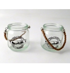 An assortment of glass candle holders with rope handles