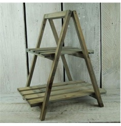 A rustic style plant stand with two shelves
