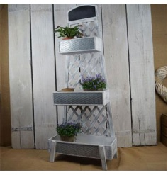 Rustic wooden plant stand with trellis design