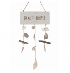 Wooden beach house sign with hanging shel decorations