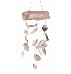 A pretty driftwood beach sign with hanging oyster shells