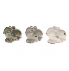 An assortment of three ceramic rabbit ornaments