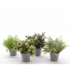 Artificial plants in an assortment each in metal pots