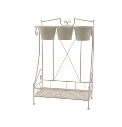 A beautiful cream iron plant stand for display and home use. A great multi-use item.