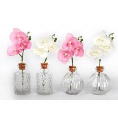 An assortment of 4 glass bottles each with a pretty silk orchid inside