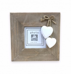 Wooden frame with shabby hanging hearts